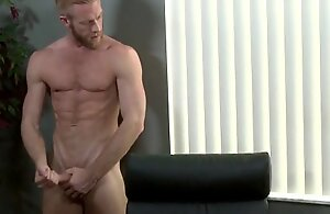 Elated ginger hunk with a cockring wanking